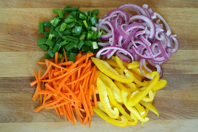 Vegetable lo mein ingredients on a cutting board