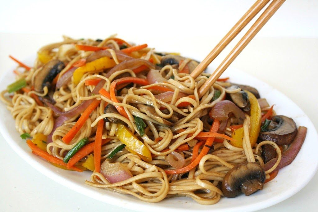 Vegetable Lo Mein on a plate with chopsticks
