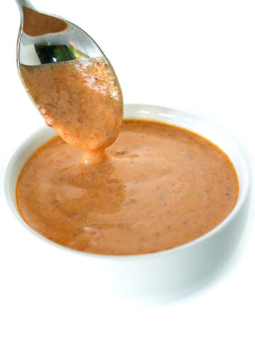 Vegan chipotle sauce in a bowl with spoon