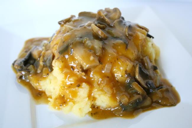 Plate with mashed potatoes and vegan mushroom gravy