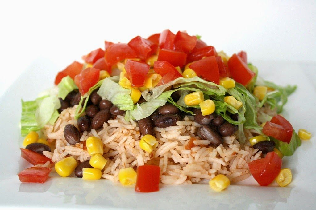 Preparing the rice with beans and vegetables