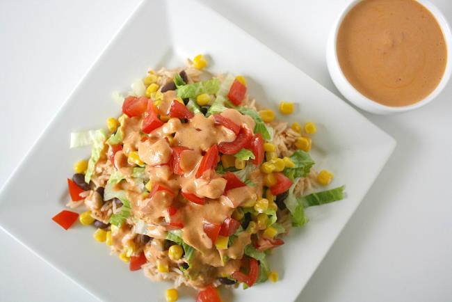 Vegan black bean and rice burrito bowl with chipotle sauce