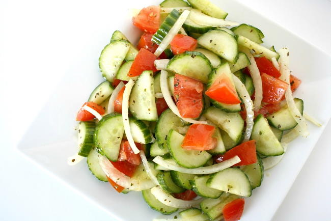 overhead view of cucumber tomato salad on a plate