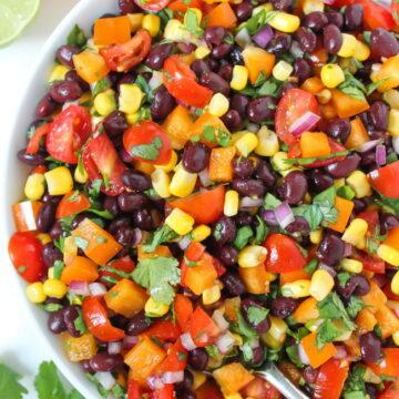 Vegan southwest black bean salad with citrus dressing in a bowl
