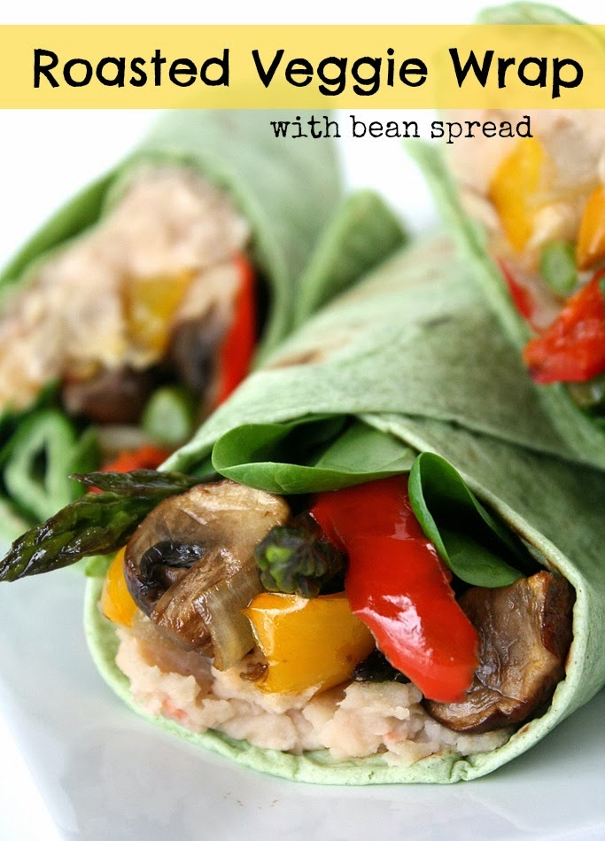 Plate with roasted vegetables wraps in spinach tortillas