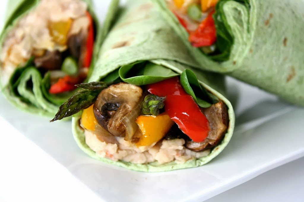 Vegan roasted veggie wraps on a plate