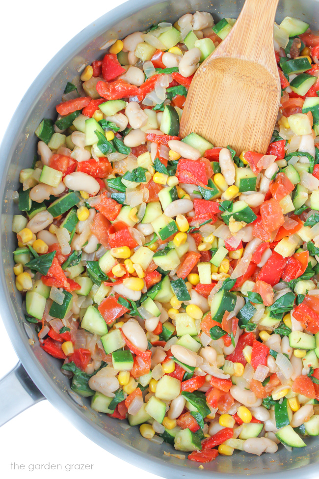 Filling for vegan zucchini tomato enchiladas in a pan