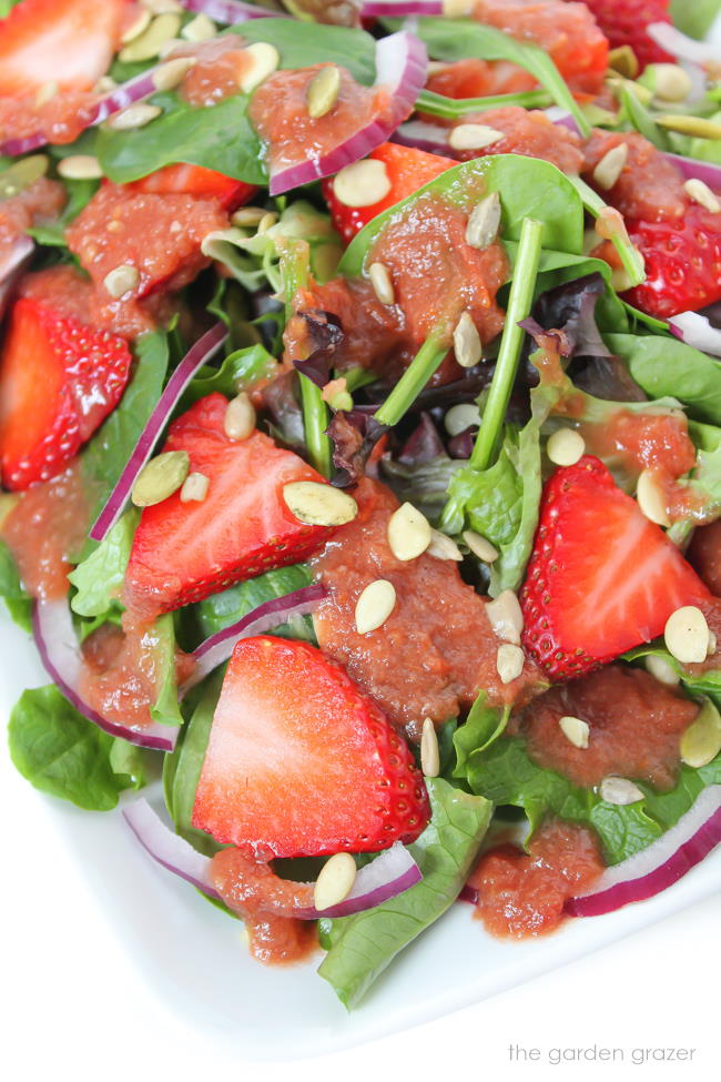 Strawberry Spinach Salad on a plate with balsamic dressing
