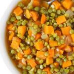 Vegan split pea soup with sweet potato in a white bowl