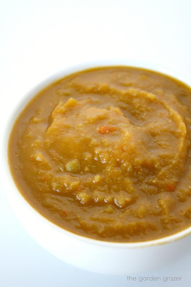 Blended split pea and sweet potato soup in a white bowl