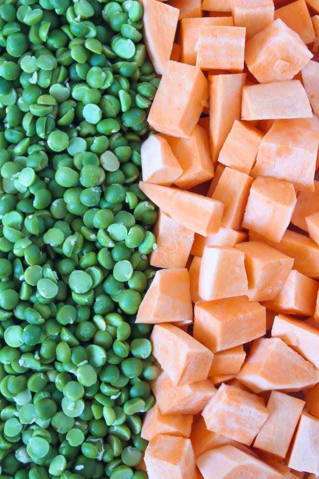 Green split peas arranged next to cubed raw sweet potatoes