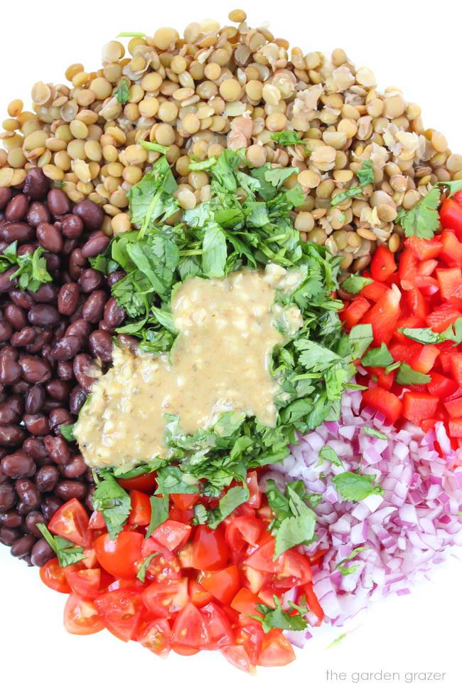 Ingredients in a bowl for black bean lentil salad