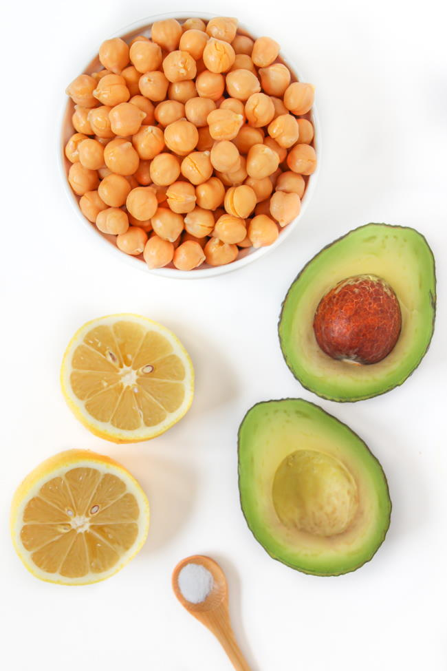 Ingredients laid out on a white table for chickpea avocado mash