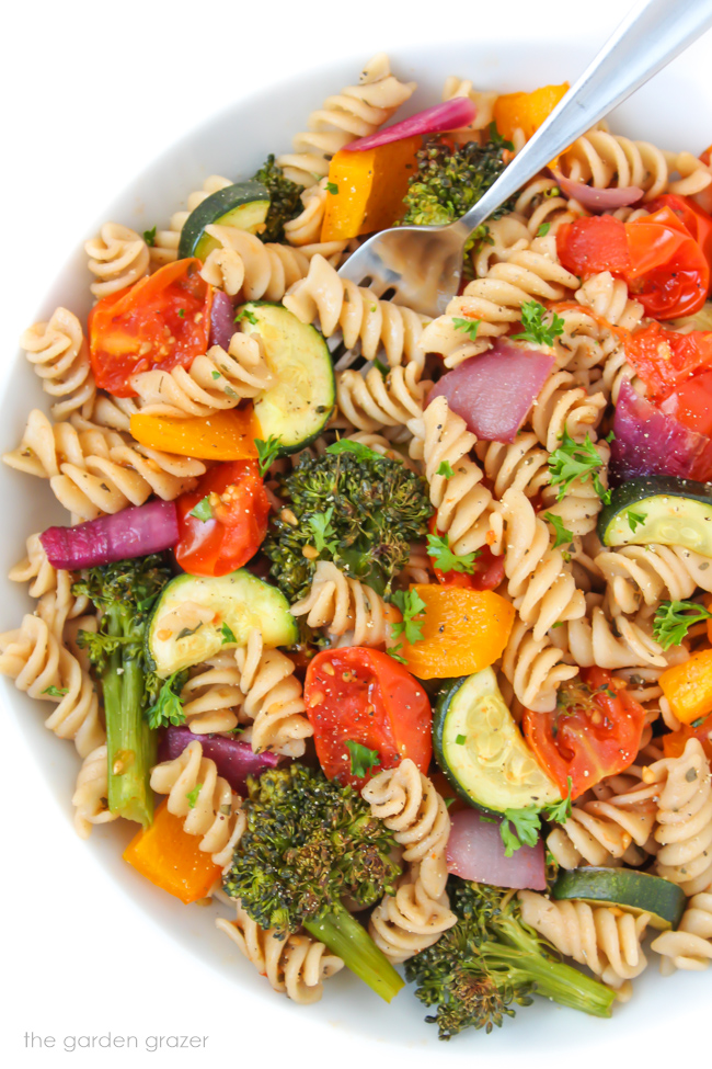 Bowl of roasted vegetable pasta with balsamic dressing