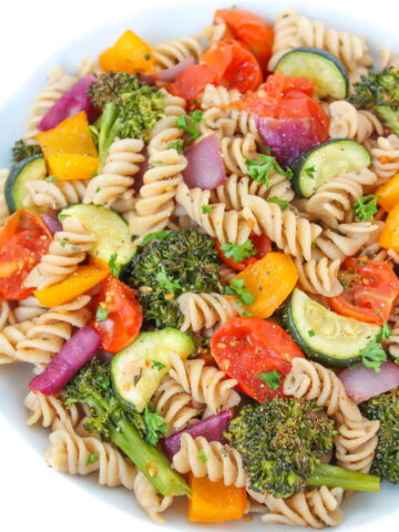 Vegan roasted vegetable pasta with balsamic in a white bowl