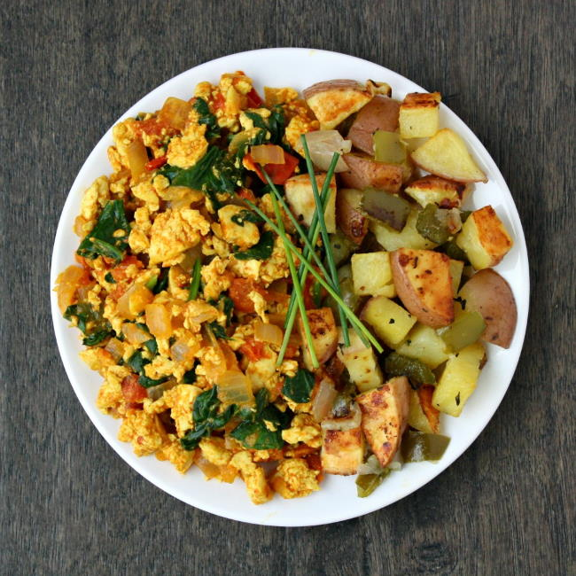 Plate of tofu scramble with roasted breakfast potatoes