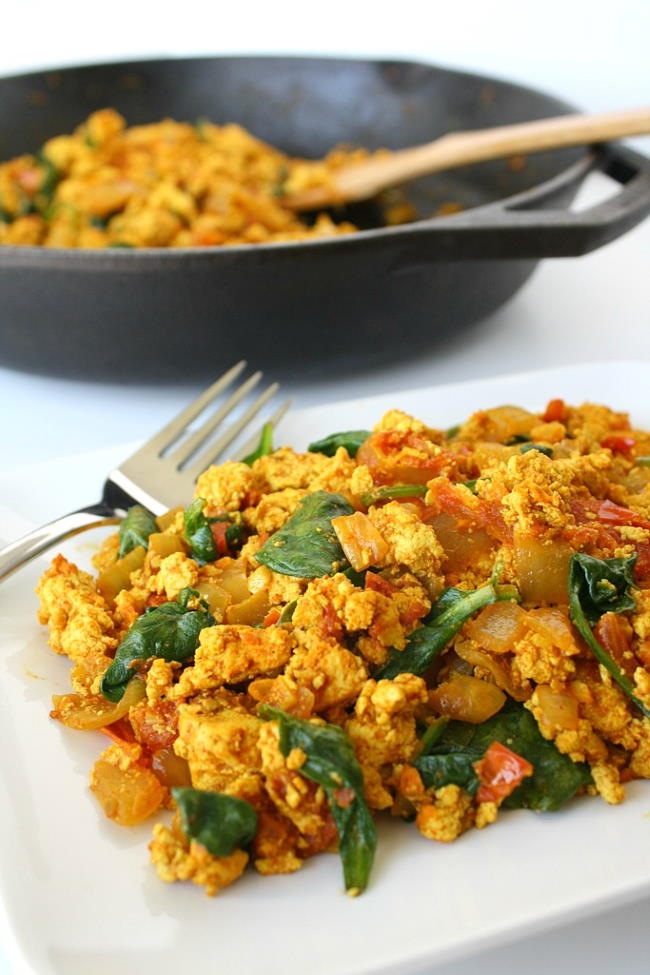 Plate of tofu scramble with skillet in background