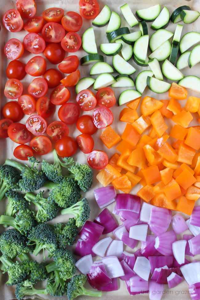 Sheet pan of chopped vegetables ready to be roasted