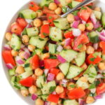 Greek Chopped Salad in a bowl with spoon