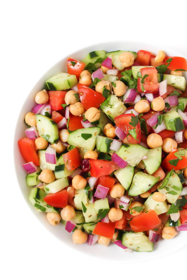 Vegan Greek Salad with tangy dressing in a bowl