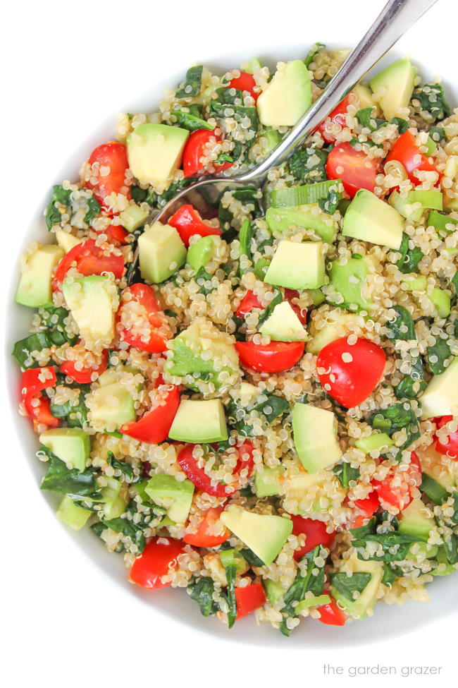 Quinoa Avocado Spinach Power Salad in a bowl with spoon