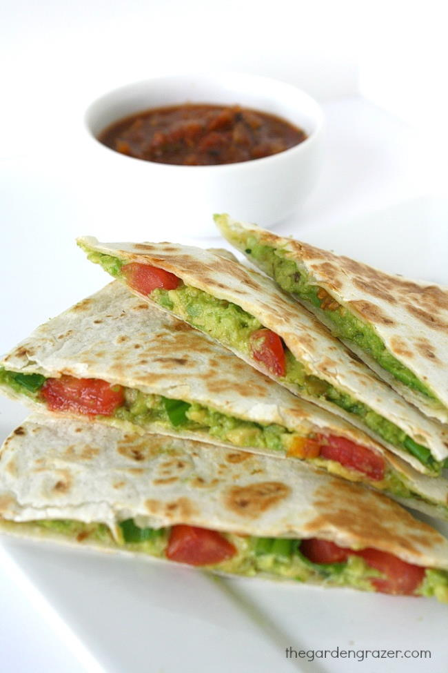 Avocado Quesadillas on a plate with bowl of salsa