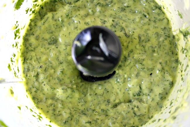 Creamy vegan avocado cilantro sauce in food processor