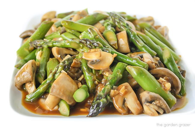 Plate of asparagus mushroom stir fry with garlic sauce