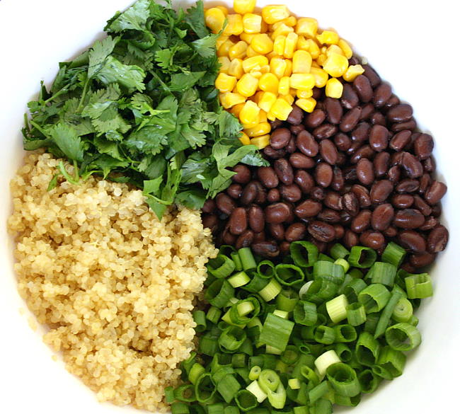 Ingredients in a bowl for black bean avocado enchiladas