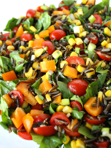 Vegan wild rice salad with spinach and vegetables on a plate