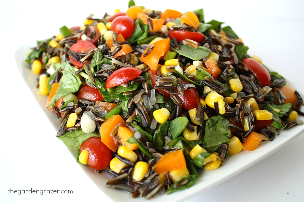 Plate of wild rice spinach salad with tomatoes