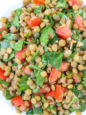 Bowl of Lentil Balsamic Salad with spinach and capers