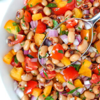 Vegan black eyed pea salad in a bowl with spoon