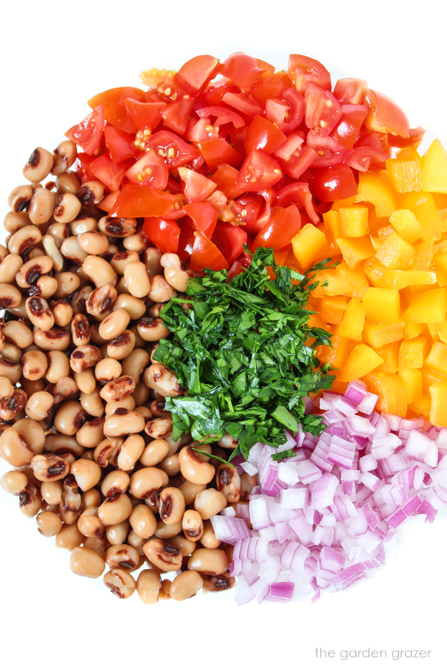 Ingredients in a bowl for black eyed pea salad