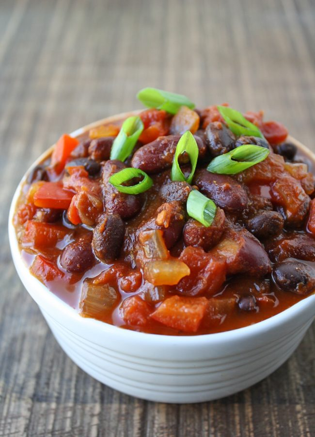 Vegan black bean chili in a bowl on a table