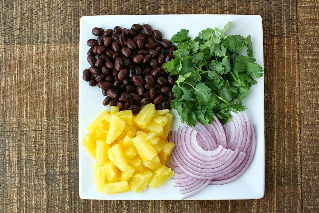 Topping ingredients for BBQ pizza on a plate