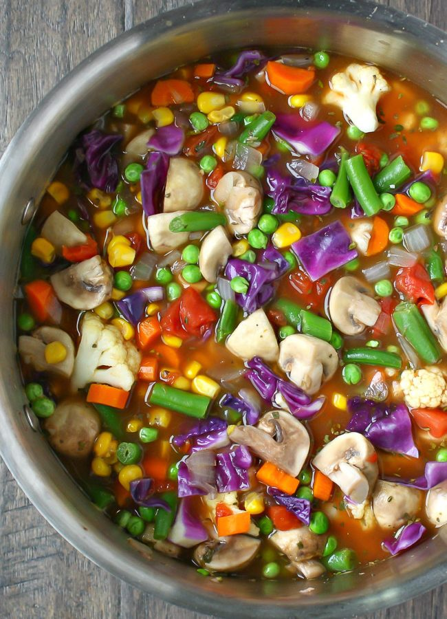 Colorful vegetable soup in a stockpot