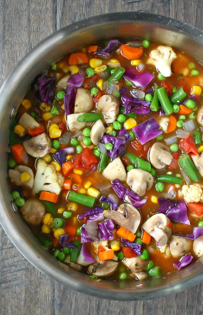 Vegan vegetable soup cooking in a large stockpot