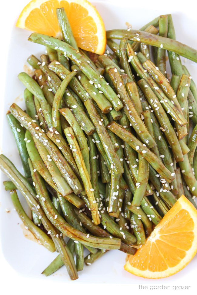 Plate of hoisin roasted green beans with orange
