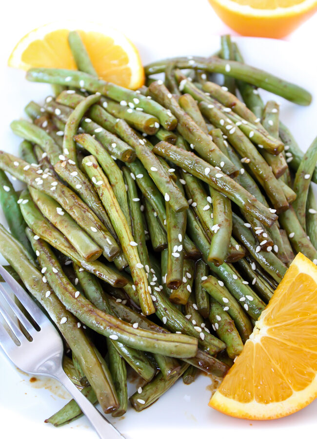 Hoisin orange roasted green beans on a plate