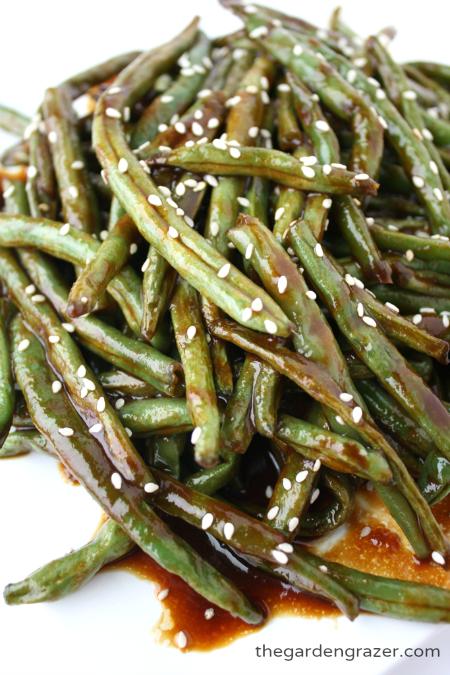 Vegan hoisin roasted green beans on a plate