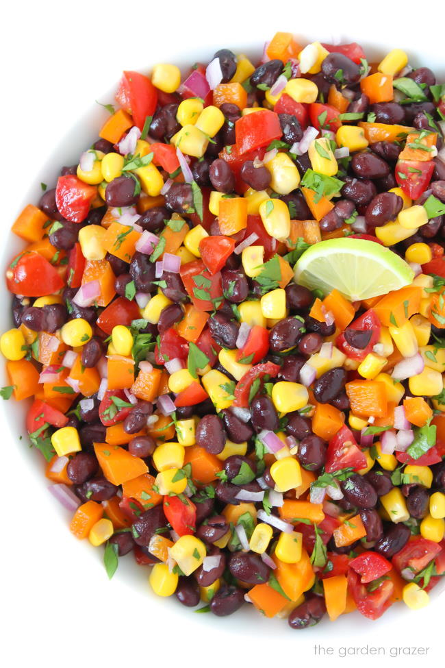 Bowl of black bean corn salsa with lime