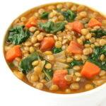 Bowl of vegan lentil spinach soup