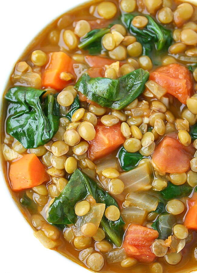 Close-up view of lentil spinach soup in a bowl