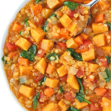 Bowl of vegan red lentil sweet potato stew with spoon
