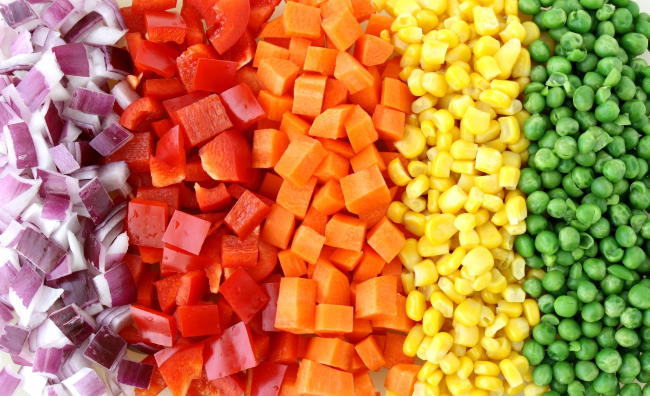 Ingredients on a cutting board for veggie fried rice