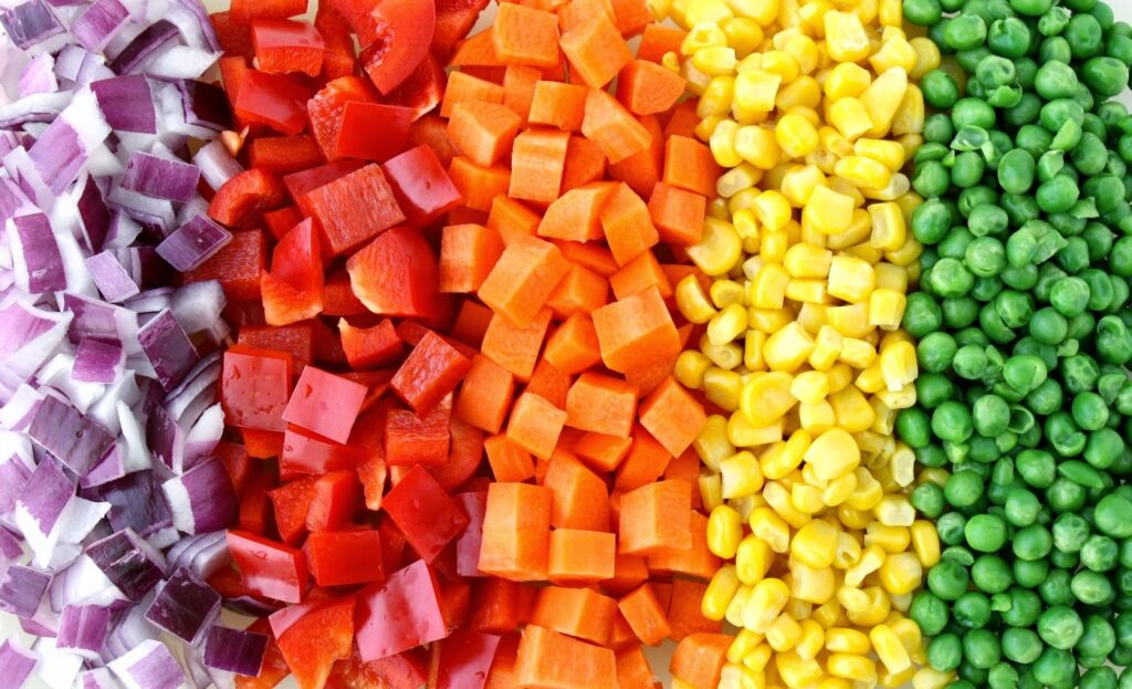 Diced vegetables sorted by color