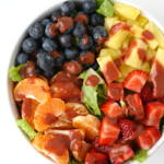 Fruit salad with strawberry vinaigrette in a bowl