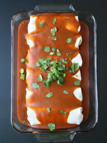 Pan of protein monster vegan enchiladas hot from the oven