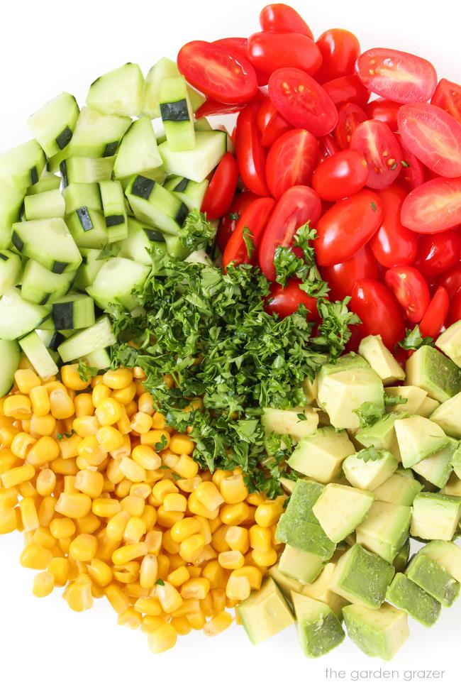 Summer blast avocado salad ingredients in a bowl